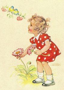 Petite fille en robe rouge